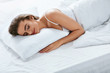Soft Pillow. Female Sleeping In Bed On White Bedding