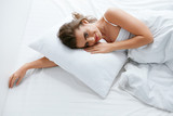 Woman On Bed, Lying On White Bedding With Pillow - 208250092