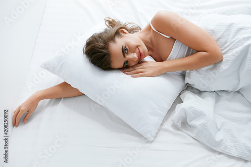 Fotobehang Hoogte schaal Woman On Bed, Lying On White Bedding With Pillow