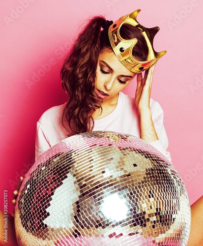 young cute disco girl on pink background with disco ball and cro - 208257073