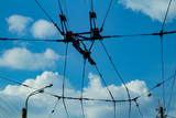 Tram wires against the blue sky, electric wires