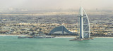 DUBAI - NOVEMBER 2016: Luxury beach of Dubai and Burj Al Arab. The Bur is the most exclusive hotel of the world, with seven stars