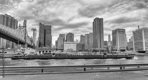 Aluminium New York Manhattan and East River view from Roosevelt Island on a cloudy day
