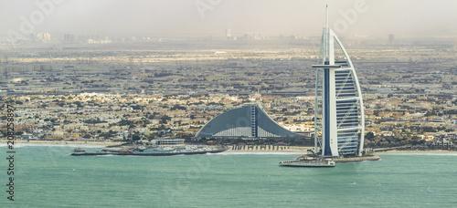 DUBAI - NOVEMBER 2016: Luxury beach of Dubai and Burj Al Arab. The Bur is the most exclusive hotel of the world, with seven stars
