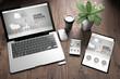 Leinwanddruck Bild - three devices on wooden desk top view interior design website