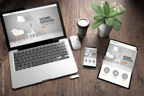 Leinwanddruck Bild three devices on wooden desk top view interior design website