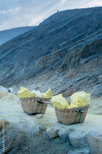 Fotobehang Blauwe jeans Baskets of sulfur, Java, Indonesia