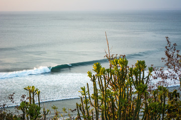 surfer as seen from the cliff, bali, indonesia © Eric