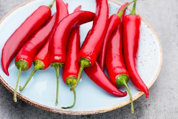 Chili cayenne pepper on grey background. © gitusik