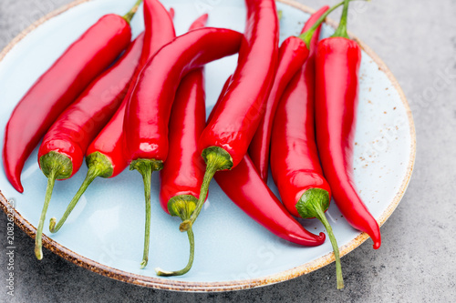 Aluminium Hot chili peppers Chili cayenne pepper on grey background.