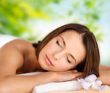 wellness, spa and beauty concept - close up of beautiful woman over green natural background
