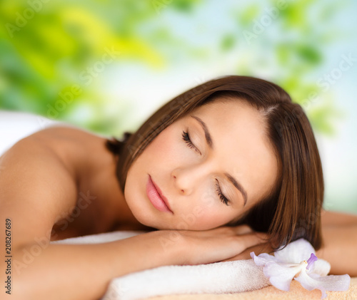 Aluminium Spa wellness, spa and beauty concept - close up of beautiful woman over green natural background