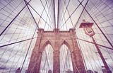Looking up at the Brooklyn Bridge, color toned picture, New York City, USA. - 208273207