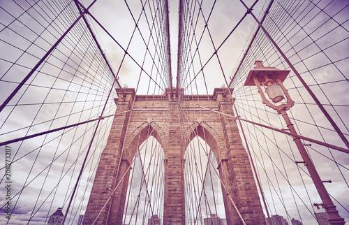 Aluminium Brooklyn Bridge Looking up at the Brooklyn Bridge, color toned picture, New York City, USA.