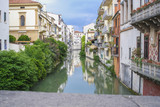 Padova, Italy - May, 6, 2018: Houses on a bank of channel in Padova - 208278222