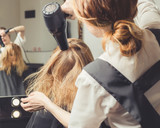 Beautician blow dry woman's hair at beauty salon - 208283226