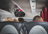 View from inside the bus with passengers. - 208289821