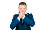 A young businessman covered his mouth with his hands. I can not say the concept - 208303255