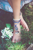 woman summer boho fashion style details on barefoot anklets and rings outdoor summer day - 208305657