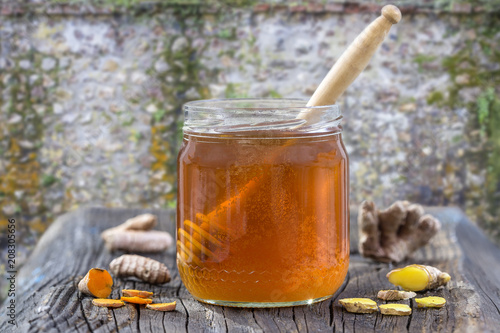 Aluminium Spa Natural Spa healthcare Ingredients . - Turmeric curcuma, ginger, and honey for skin care. on exterior old flint, wall background