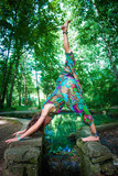 young woman practice yoga in park in front pond summer day - 208306471