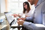 Two Businesspeople Analyzing Gantt Chart - 208323082