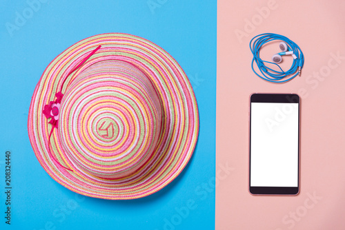 flat lay of fashion hat and smart phone on color paper , minimal style background