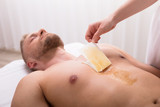 Man Waxing Chest In Spa