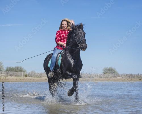 riding woman on the beach