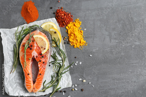 salmon steak with spices on the table - 208352823