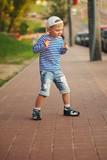 little boy dancing on the street - 208354460