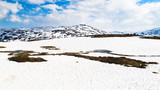 Mountain landscape with melting snow and ice in Telemark, Norway.