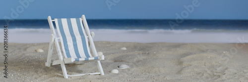 Blue white striped deck chair on the beach, panorama - 208366634