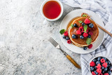 Healthy summer breakfast,homemade classic american pancakes with fresh berry and honey, morning light grey stone background copy space above - 208367860