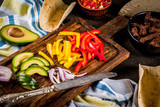 Making Mexican pork tacos with vegetables and salsa, set of cooking ingredient on dark rusty table - 208367888