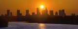 Panorama Warszawy na tle zachodzącego słońca - 208370094