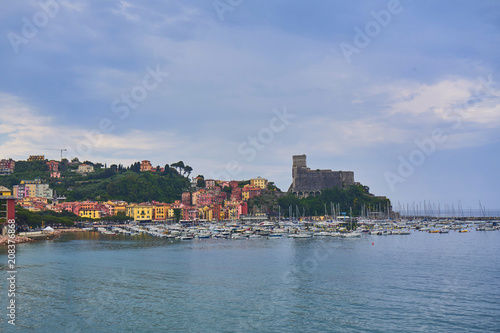Fotobehang Liguria Colorful Houses and Seascape with Old castle and Blue Cloudy Sky