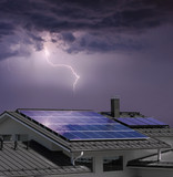 House with solar panels in thunderstorm - 208384632