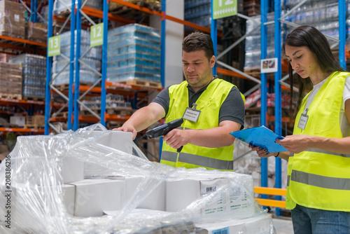 Leinwanddruck Bild Scanning the goods in warehouse