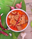 red curry on wooden background - 208397462