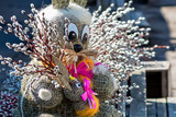 Straw-shaped bunny shapes with willow branches twings. Easter decorations. Easter holidays.