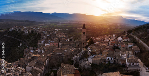 Small village on the valley at sunset (Pacentro - Italy)