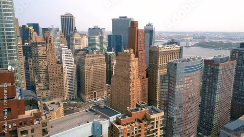Aerial view of Manhattan downtown, financial centre, New York City. Skyscrapers around. Drone shot. © dimid_by