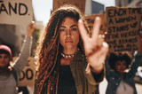 Woman showing a peace sign during protest - 208427645