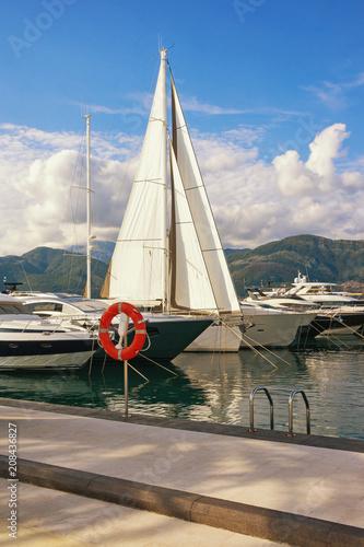 Fotobehang Beige Mediterranean port. Montenegro, Tivat, view of luxury yacht marina of Porto Montenegro in Adriatic