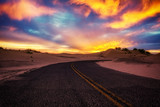 Road into sunset sand dunes