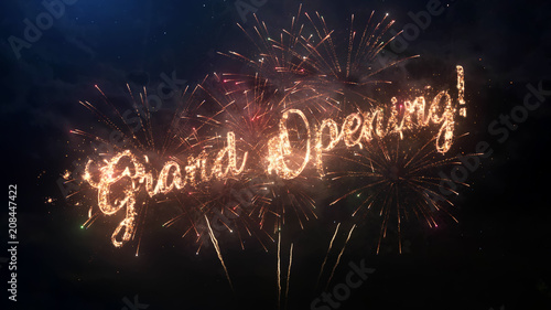 grand opening greeting text with particles and sparks on black night sky with colored fireworks on