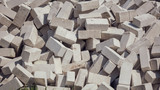 Gray bricks on construction site as background - 208462842
