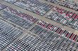 Leinwanddruck Bild - New cars from the car factory parked at the port waiting for export to the country as orderedNew cars from the car factory parked at the port waiting for export to the country as ordered