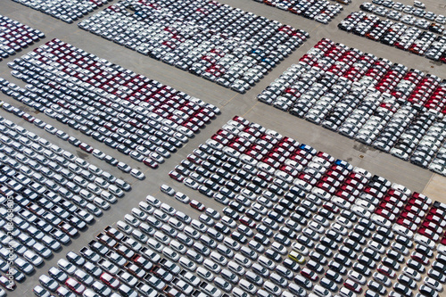 Leinwanddruck Bild New cars from the car factory parked at the port waiting for export to the country as orderedNew cars from the car factory parked at the port waiting for export to the country as ordered